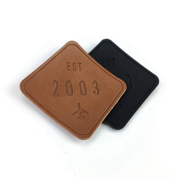 Durable garment leather patch embossed